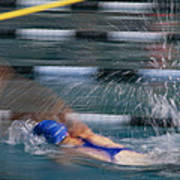 A Swimmer Races Through The Water Poster