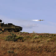A Tow Missile Is Launched From An Poster
