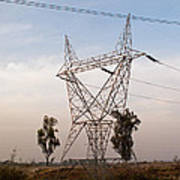 A Transmission Tower Carrying Electric Lines In The Countryside Poster