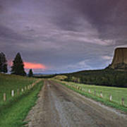 A Twilight View Down A Dirt Road Poster