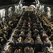 A Unit Of U.s. Army Soldiers In A C-17 Poster