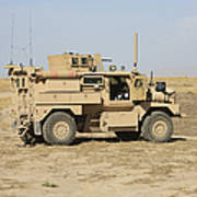 A U.s. Army Cougar Mrap Vehicle Poster