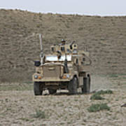 A U.s. Army Cougar Patrols A Wadi Poster