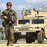 A U.s. Marine Guides A Humvee Poster