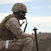 A U.s. Marine Uses A Field Phone Poster