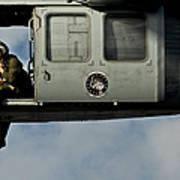 A U.s. Navy Naval Air Crewman Guides Poster