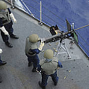 A U.s. Sailor Fires A .50-caliber M2hb Poster