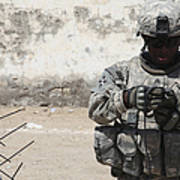 A U.s. Soldier Tests A Tactical Poster