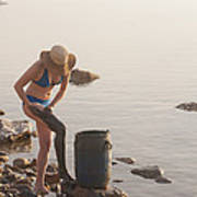 A Woman Smears Therapeutic Dead Sea Mud Poster