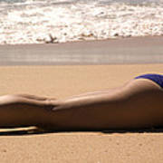 A Woman Sunbathes On The Beach Poster