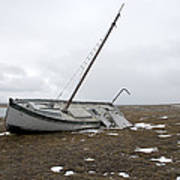 A Wooden Sailboat Is Beached Poster