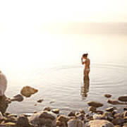 A Young Woman Wades Into The Dead Sea Poster