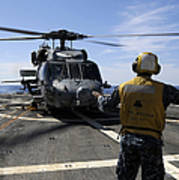 Airman Signals To An Mh-60s Sea Hawk Poster