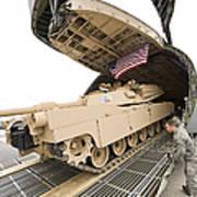 Airmen Load A Tank Into A C-5m Super Poster