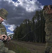 Airmen Use A Range Finder And Gps Unit Poster