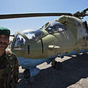 An Afghan Army Soldier Guards An Mi-35 Poster