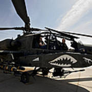 An Ah-64d Apache Helicopter Parked Poster