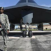 An Airman Guards A B-2 Spirit Poster