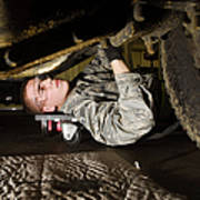 An Airman Inspects The Undercarriage Poster by Stocktrek Images