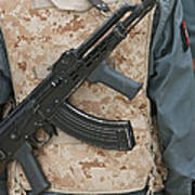 An Ak-47 Rests On The Sling Of An Poster