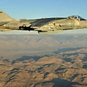 An Av-8b Harrier Conducts A Test Flight Poster