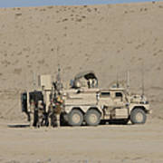 An Eod Cougar Mrap In A Wadi Poster