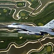 An F-16 Fighting Falcon Flies Near Base Poster