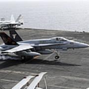 An Fa-18a+ Hornet Lands Aboard Poster