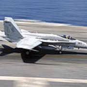 An Fa-18e Super Hornet Lands Aboard Uss Poster