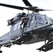 An Hh-60g Pavehawk Helicopter In Flight Poster