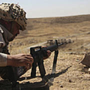 An Iraqi Army Soldier Prepares To Fire Poster