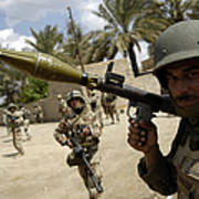 An Iraqi Army Soldier Provides Security Poster by Stocktrek Images