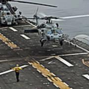 An Mh-60s Sea Hawk Lands Aboard Poster