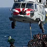 An Mh-60s Sea Hawk Picks Up Pallets Poster