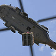 An Mh-60s Seahawk Helicopter Airlifts Poster