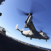 An Mv-22 Osprey Lands Aboard The Uss Poster