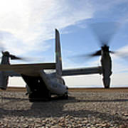 An Mv-22 Osprey Sits Outside A Forward Poster
