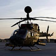 An Oh-58d Kiowa During Sunset Poster