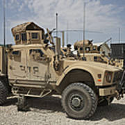 An Oshkosh M-atv Parked At A Military Poster