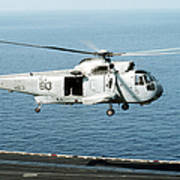 An Sh-3h Sea King Helicopter Prepares Poster