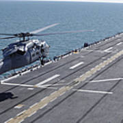 An Sh-60 Sea Hawk Helicopter Lands Poster