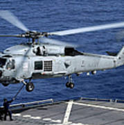An Sh-60b Seahawk Helicopter Performs Poster