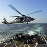 An Sh-60r Sea Hawk Delivers Pallets Poster