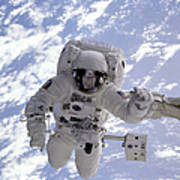 Astronaut Gernhardt On Robot Arm Poster
