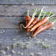 Baby Carrots On Rustic Table Poster