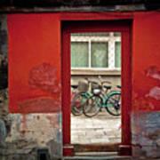 Bicycles In Red Doorway Poster