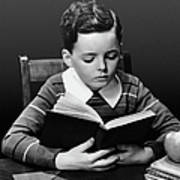 Boy Reading Book At Desk Poster