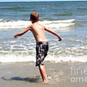 Boy Running Into Surf Poster