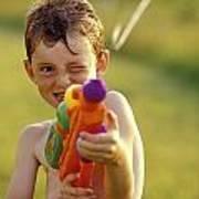 Boy Spraying Water Gun Poster