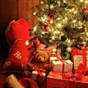Brightly Lit Christmas Tree With Gifts Poster